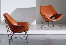 A Pair of Cognac Leather Chairs